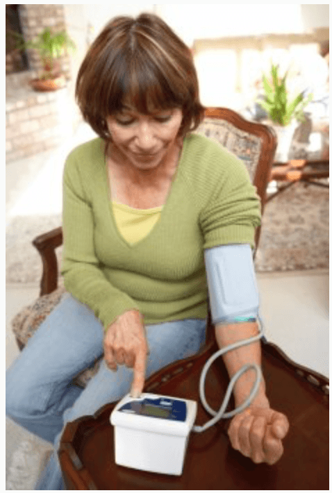 woman checking blood pressure